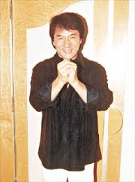 This picture shows Hong Kong superstar Jackie Chan saying thank you to his fans in Chinese, demonstrating a characteristic Chinese handshake motion, useful if you translate thank you to Chinese.